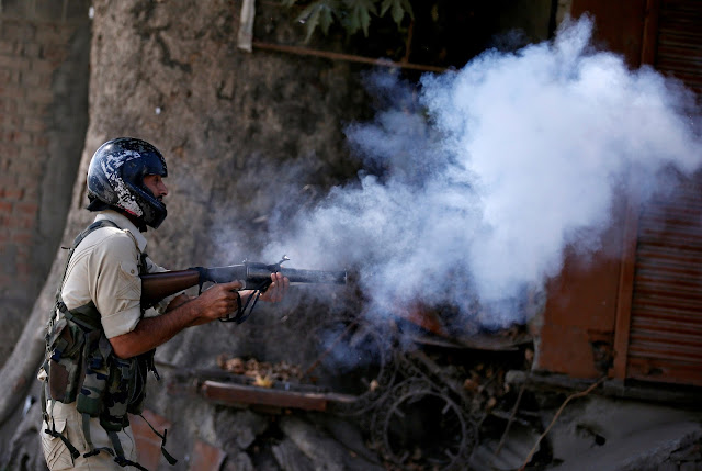 Image Attribute: An Indian policeman fires a teargas shell towards demonstrators during a protest against the recent killings in Kashmir, in Srinagar September 23, 2016.REUTERS/Danish Ismail/File Photo
