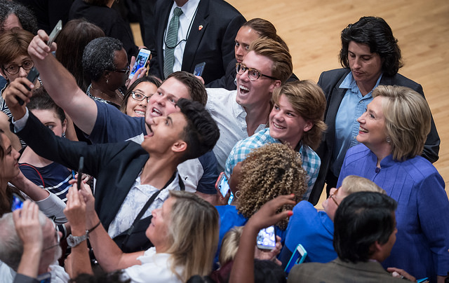 image of a group of diverse people taking a huge selfie with Hillary Clinton at a campaign event in Cincinnati
