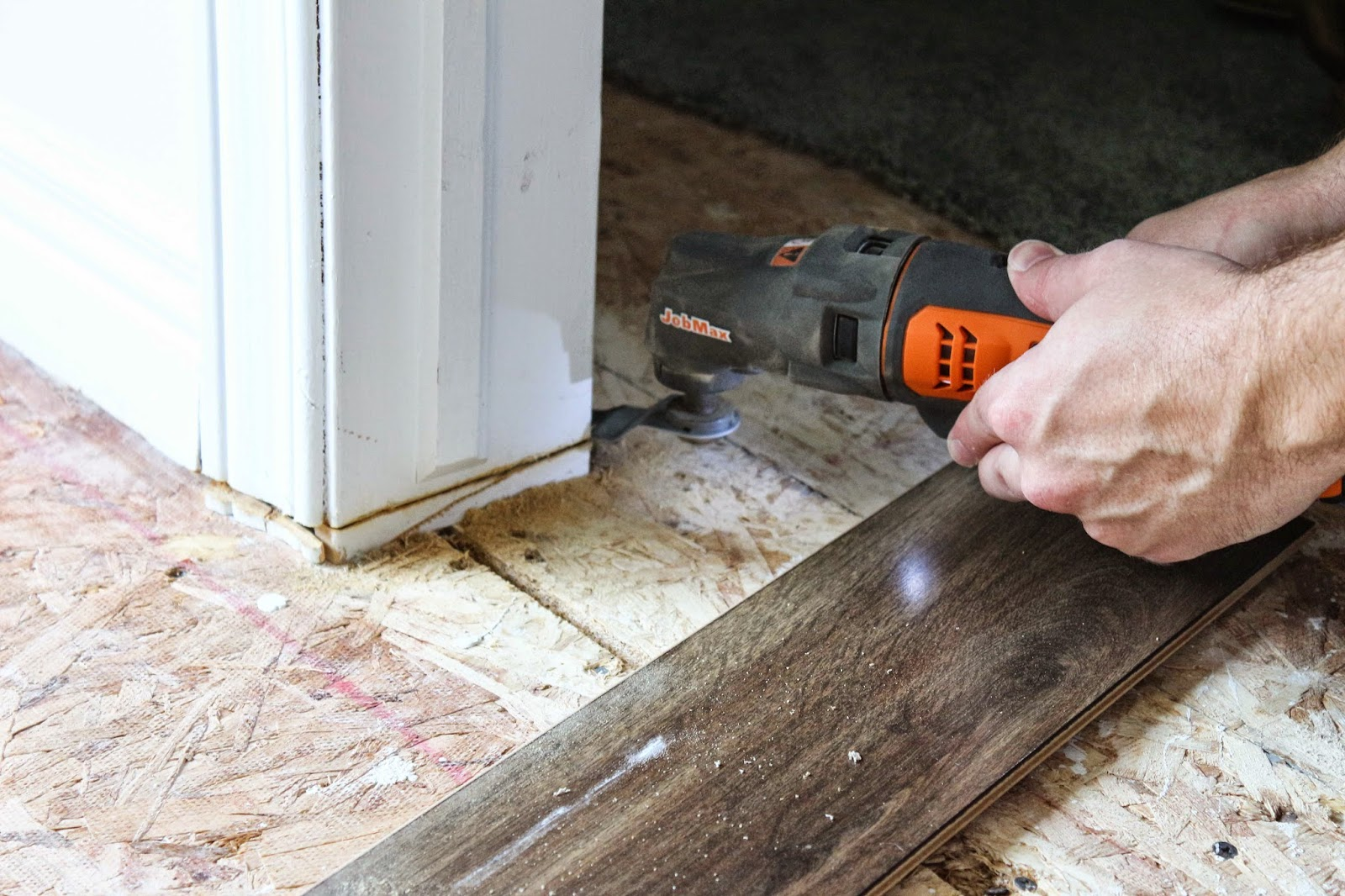 Using a multi-tool to cut door jambs