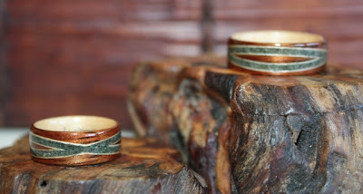 Koa wood rings with crossed spiraled moss agate inlays by Touch Wood Rings