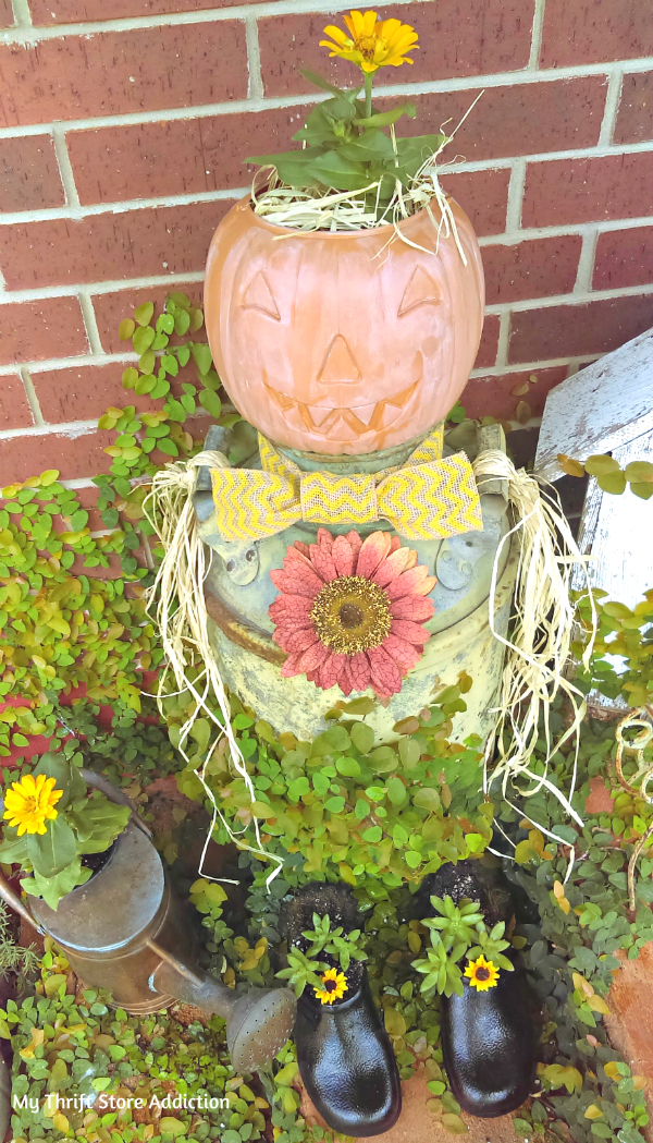 repurposed vintage milk can scarecrow and snowman