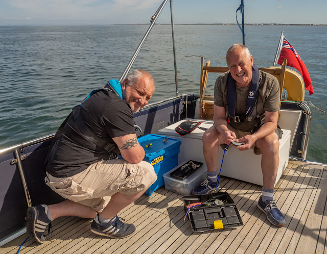 Photo of Phil (right) and Mic preparing to start fishing