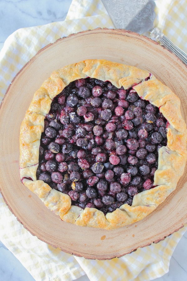 This gorgeous and rustic Blueberry Galette is so simple to make that you can have it on your table in no time! As delicious as it is beautiful, your family will devour it in no time!