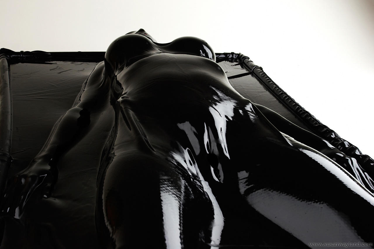 woman Latex vacuum bed
