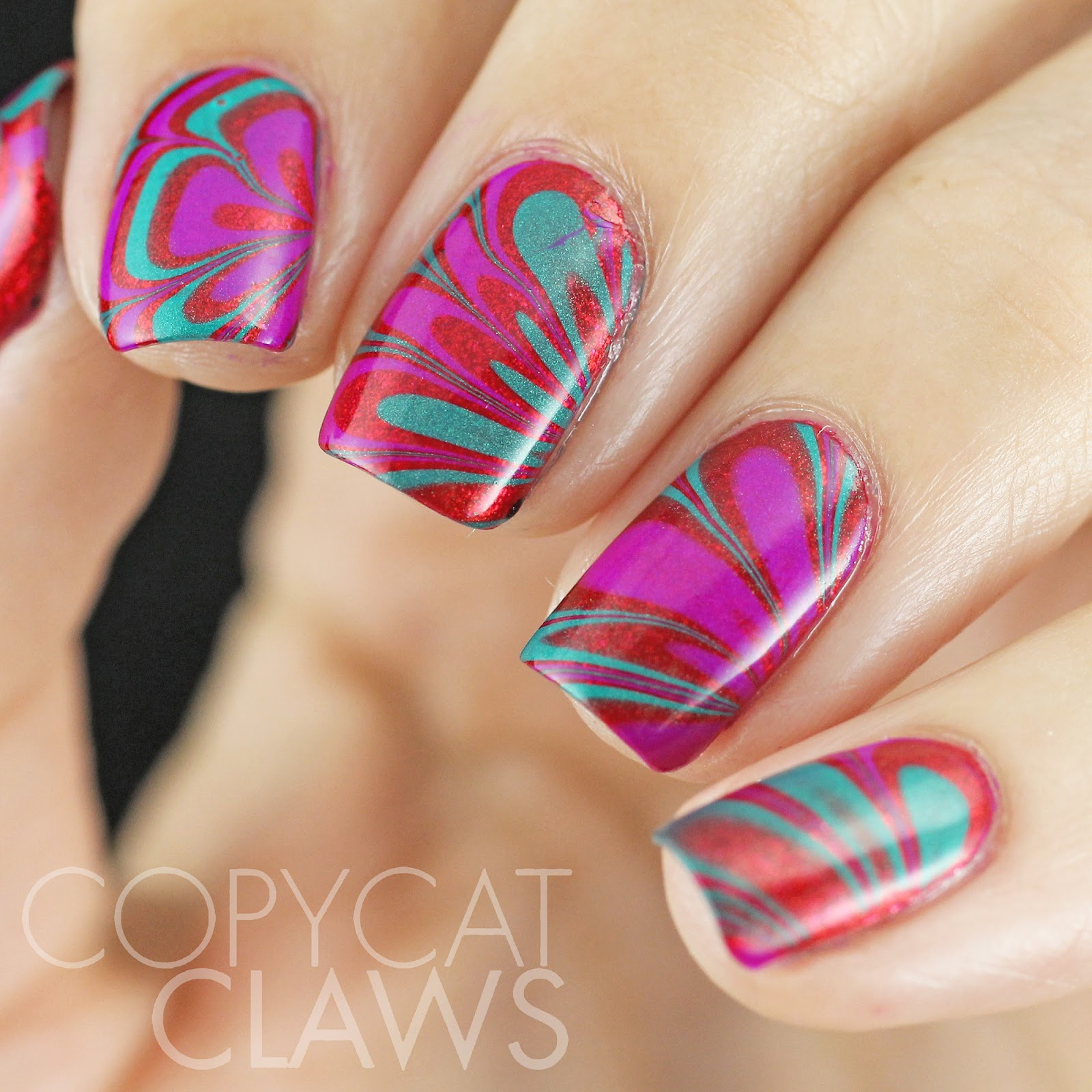 Copycat Claws: Red, Purple and Aqua Negative Space Water Marble Nails