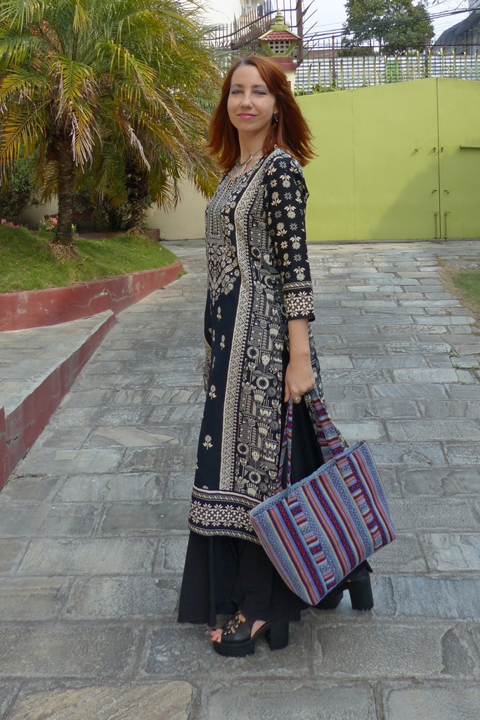 Ethnic printed tunic worn over maxi skirt