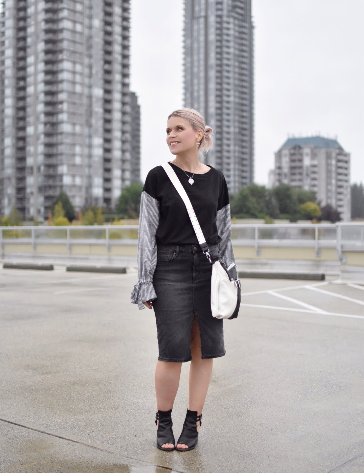 Monika Faulkner outfit inspiration - sweatshirt with mixed media sleeves, black denim skirt, cut-out booties, and a cross-body bag