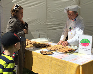 Biscuit baker on stall with custom from Polish mother and her son