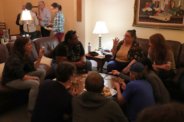 Maggie regales choir members with her gaming expertise at a recent retreat