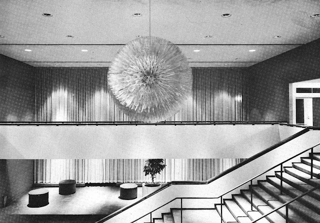 a photograph of a 1968 giant starburst chandelier, brutalist