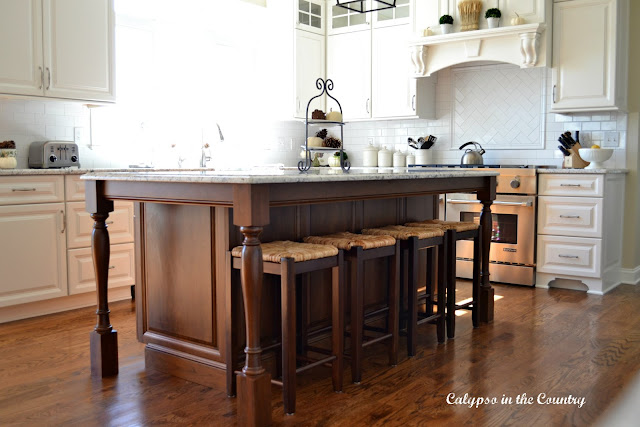 Cherry Island with rush seat wood counter stools