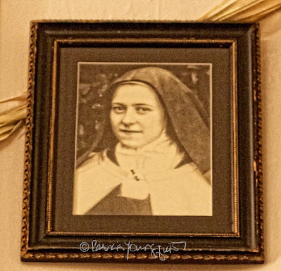 This picture is of a framed photo of  St. Thérèse de Lisieux.