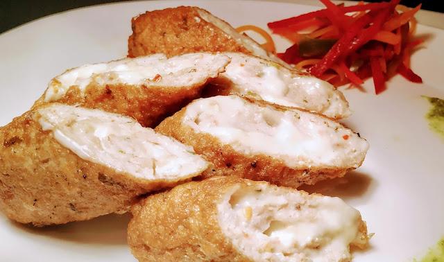 Cheesy chicken rolls serving with garnish Food recipe dinner ideas