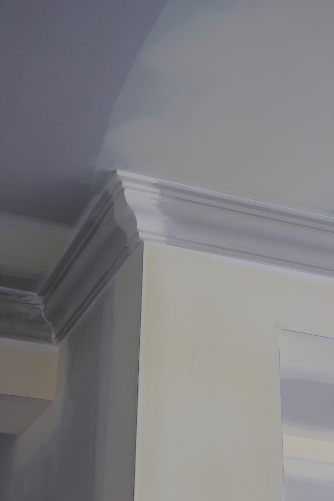 Building Our House Of Grey And White Bricking Cornices