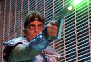 Ross Hagen as Kol in Alienator (1990)