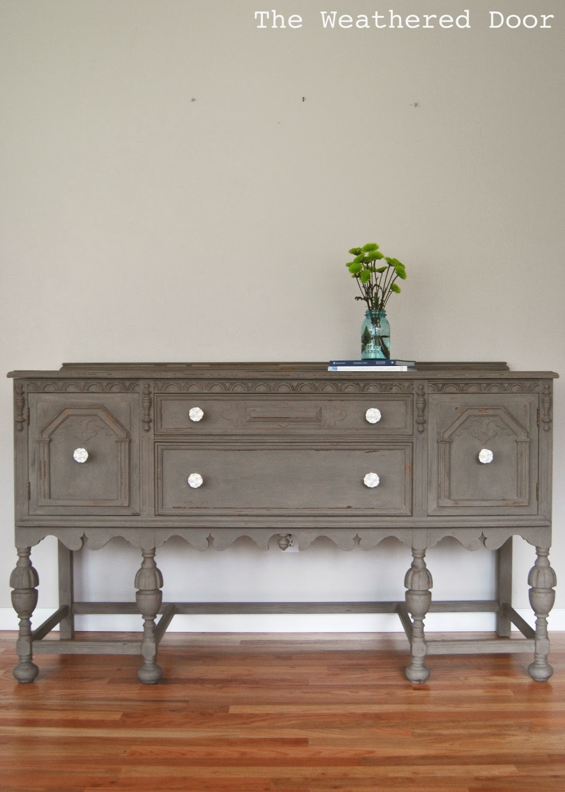 A Driftwood Buffet With White Knobs The Weathered Door