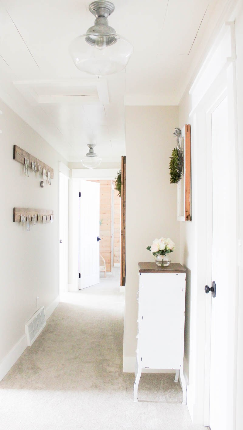 Isnt this hallway from kristi at making it in the mountains just so pretty i love the edgecomb gray as a subtle backdrop to all her decor