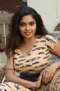 Telugu Actress Karunya Chowdary Stills in Short Dress at ATM Not Working Press Meet  0169.jpg