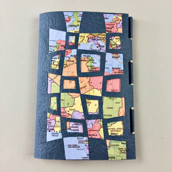 woen paper notebook made of textured paper and maps