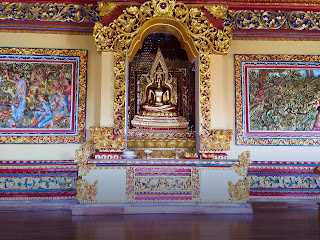 Gold Buddha Wall Sculpture and Relief In The Worship Room Brahmavihara Arama Monastery North Bali