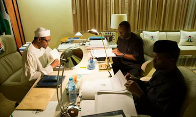 Buhari, Osinbajo budget minister taken a look at 2016 national budget approved by national assembly.