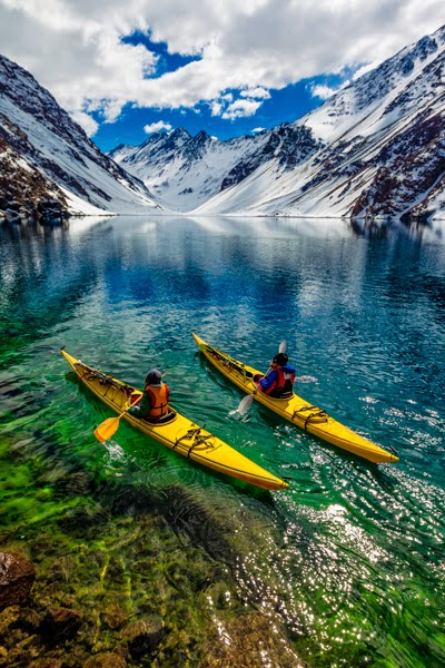 10 Best Adventure Holiday Destinations | James Heim and Michelle Parker using Kayaks to access skiing on Laguna de Incas in Portillo Chile