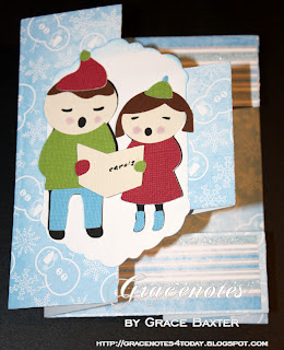 cute carolers tri-shutter card front, by Grace Baxter