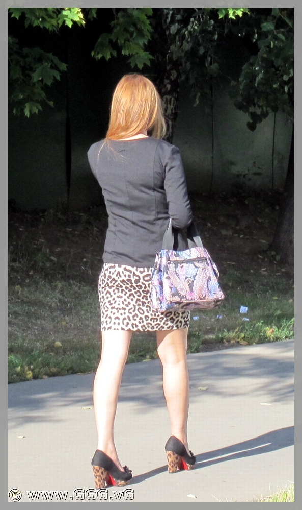 Lady in leopard skirt on high heels