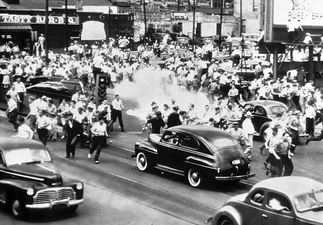 Police use tear gas to disperse a crowd gathered on the main street of Detroit, Michigan, in an effort to halt race rioting on June 21, 1943.
