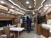 ceiling wooden scroll work and extra bright lighting inside a large class A motorhome