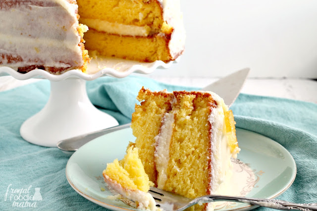 Super moist layers of lemony cake are frosted in an amazing homemade buttercream flavored with lemon curd & fresh lemon zest in this Lemon Layer Cake with Lemon Curd Buttercream.