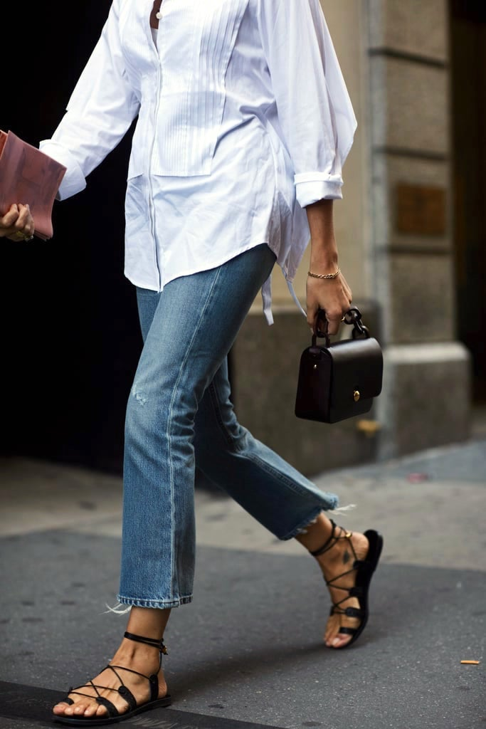 Stylish Casual Outfit Idea for Spring and Summer: Tuxedo-Style Shirt, Mini Bag, Jeans, and Flat Lace-Up Sandals