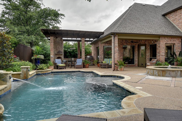 Hardscaped backyard with pool