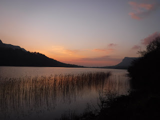View of sunset over Glencar Lake and valley