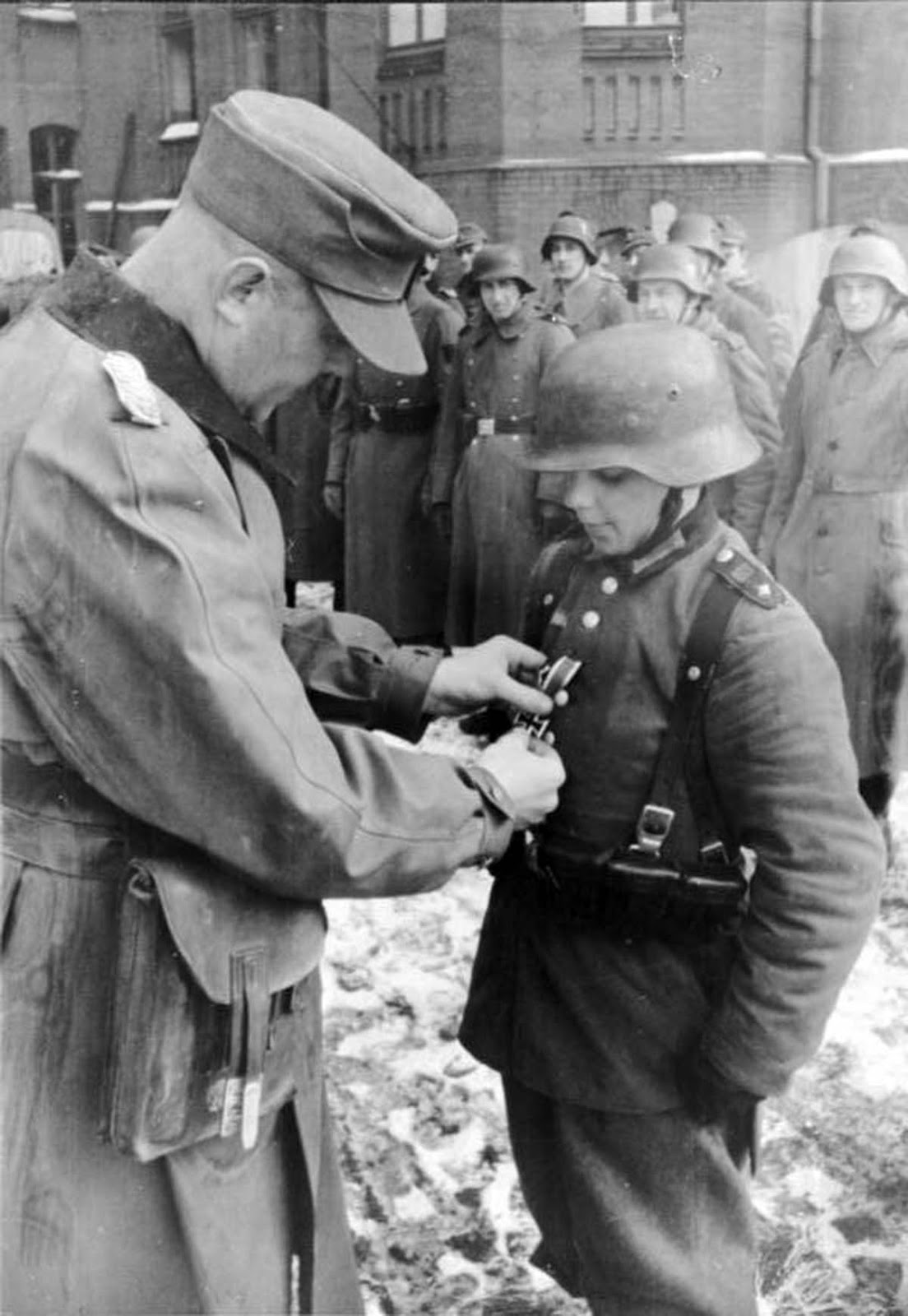 Artur Axmann, leader (Reichsjugendführer) of the Hitler Youth (Hitlerjugend), redecorating Willi Hübner.