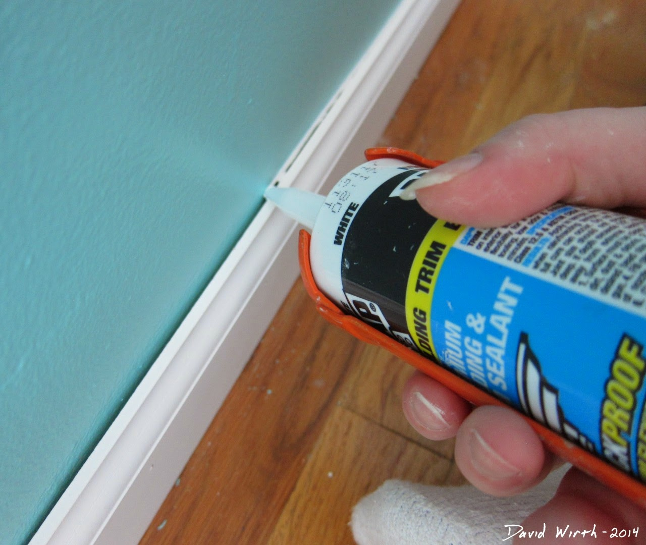 caulk baseboard, dap, trim, sealant, molding, crown molding, how to