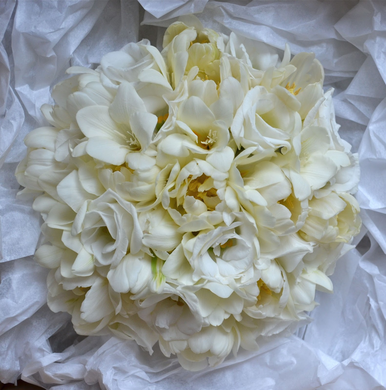 Wedding flowers blog pamelas winter white wedding flowers tithe barn winter white bouquet of double tulips freesias and lisianthus with all the freesias it smelt gorgeous too pamela was keen to avoid roses and wanted to mightylinksfo