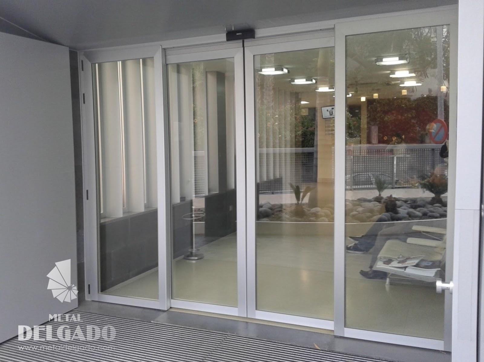 Puertas garaje tenerife tipo puertas de locales comerciales for Puertas automaticas cristal