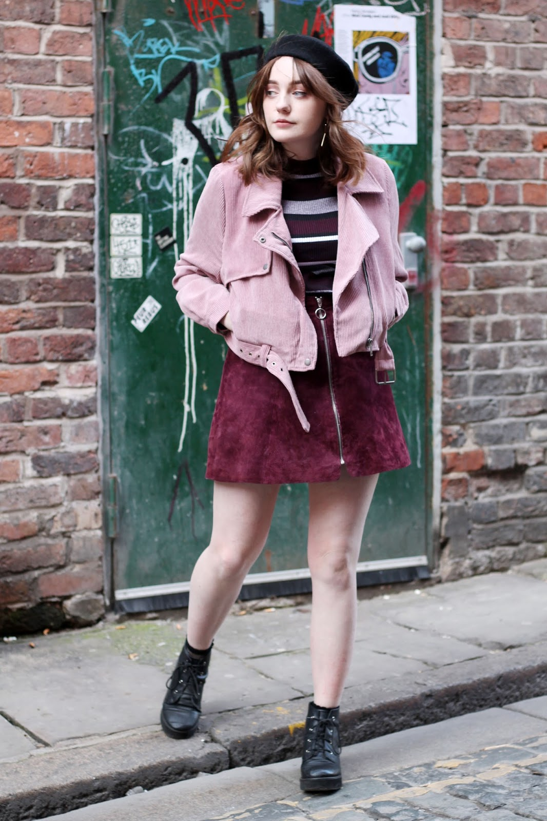 Liverpool style blogger wearing Nasty Gal pink corduroy biker jacket, black beret, Burgundy white and black stripe turtleneck jumper, Burgundy suede a line zip up skirt and black lace up boots