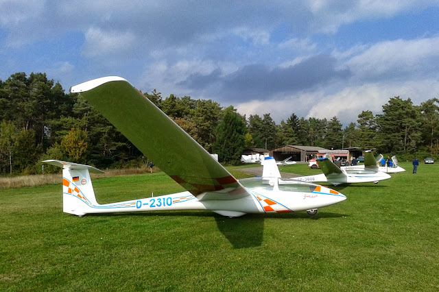 Gliders at Hayingen airfield. Infrastructure of the club in the background