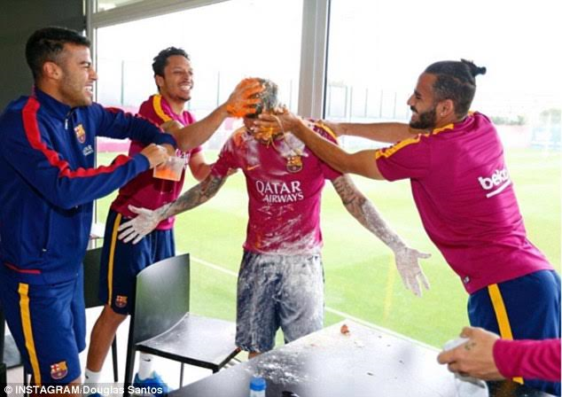 1 Photos: Barcelona players cover Dani Alves in eggs and flour at training as he celebrates 33rd birthday