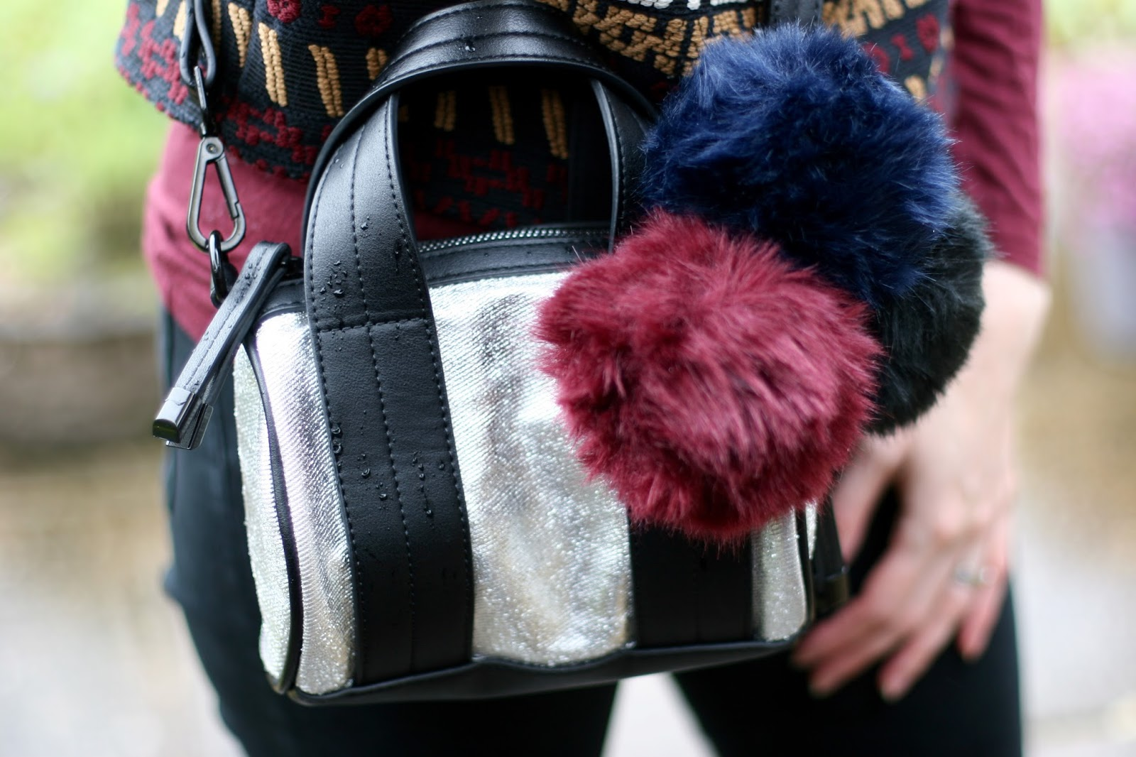 Topshop bag and pom poms.
