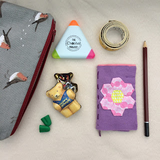 Notions pouch and contents including tape measure, needle case, pencil, highlighter