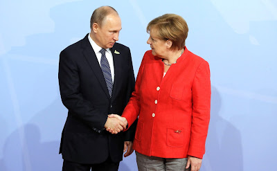 Vladimir Putin with Federal Chancellor of Germany Angela Merkel before the start of the G20 summit.
