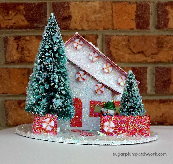 A red and white peppermint putz house