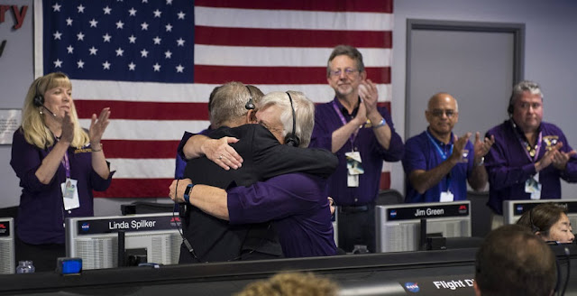 Earl Maize, program manager for NASA's Cassini spacecraft at the agency's Jet Propulsion Lab, and Julie Webster, spacecraft operations team manager for the Cassini mission at Saturn, embrace in an emotional moment for the entire Cassini team after the spacecraft plunged into Saturn, Friday, Sept. 15, 2017. Credits: NASA/Joel Kowsky