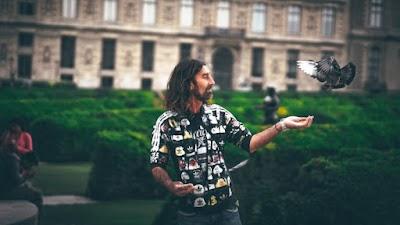Man feeding a Pigeon