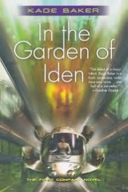 Cover of In the Garden of Iden, featuring a white spaceship zipping directly at the viewer through a blurred green background. An indistinct, white-clad figure sits at the small cockpit's controls. A blurred orange face hovers above the ship.