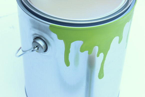 Dark colors work best to create the paint drips on this DIY paint can planter.
