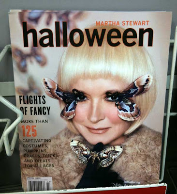 Cover of Martha Stewart Halloween magazine with Martha in ice-blond wig and false eyelashes made from half a huge moth on each eye